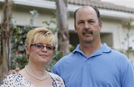 Martina Schramm and her husband Robert are seen in front of their home in Pembroke Pines, Florida February 7, 2012. REUTERS/Joe Skipper