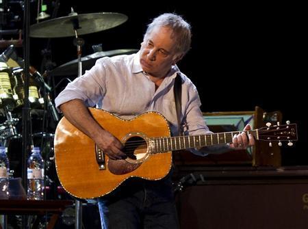 Musician Paul Simon performs onstage at the Ramat Gan Stadium near Tel Aviv July 21, 2011. REUTERS/Nir Elias