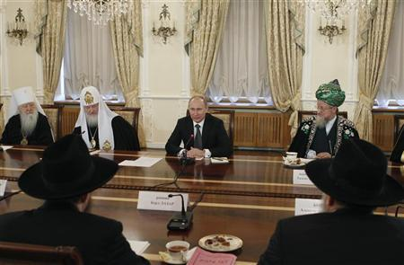 Russia's Prime Minister Vladimir Putin (2nd R) sits with Supreme Mufti of Russia Talgat Tadzhuddin (R), Metropolitan Juvenaly of Krutitsy and Kolomna (L) and Russian Orthodox Patriarch Kirill during his meeting with religious leaders at the Danilov Monastery in Moscow February 8, 2012. REUTERS/Grigory Dukor