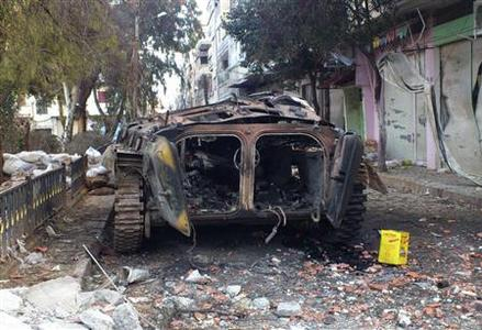 A damaged armoured military vehicle is seen after clashes between President Bashar al-Assad forces and Free Syrian Army (FSA) in Cairo square near Khaldiyeh area in Homs February 4, 2012. REUTERS/Stringer