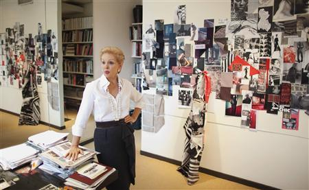 Designer Carolina Herrera poses for a portrait as she takes a break from preparing for her upcoming show in New York's Fashion Week at her studio in New York February 2, 2012. REUTERS/Lucas Jackson
