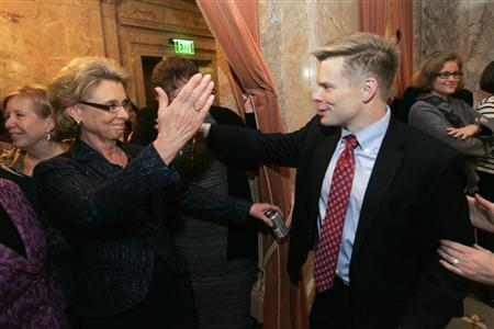 Washington Governor Chris Gregoire (L) and state House Representative Jamie Pederson congratulate each after the state house passed a bill endorsing gay marriage in the state in Olympia, Washington February 8, 2012. REUTERS/Robert Sorbo