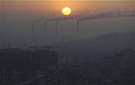 Smoke billows from the chimneys of a power plant during sunrise in Jiaxing, Zhejiang province December 23, 2011. REUTERS/Stringer