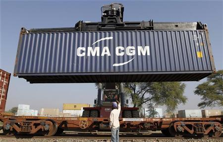 A container is unloaded from a freight train at Thar Dry Port in Sanand in Gujarat February 1, 2012. REUTERS/Amit Dave