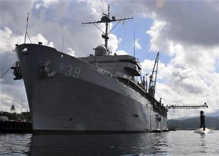 The Virginia-class attack submarine USS Texas moors alongside the submarine tender USS Emory S. Land in Subic Bay November 10, 2011. REUTERS/U.S. Navy photo by Mass Communication Specialist 1st Class David R. Krigbaum/Handout