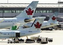 <p>Air Canada aircraft are seen at Toronto Pearson International Airport, September 20, 2011. REUTERS/Mark Blinch</p>