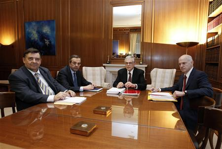 Far-right leader George Karatzaferis (L), conservative party leader Antonis Samaras (2nd L), Prime Minister Lucas Papademos (C) and Socialist leader George Papandreou meet at the Prime Minister's office in Athens, February 8, 2012.   REUTERS/Yiorgos Karahalis