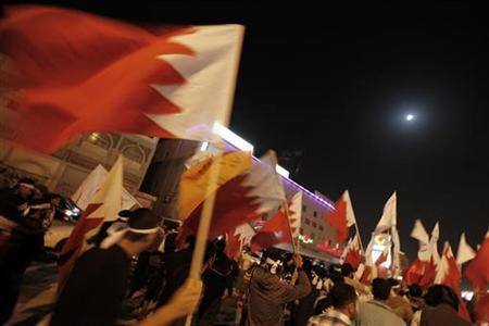 Protesters wave Bahraini flags as they march on a highway to take part in a week-long anti-government sit-in in Budaiya, west of Manama, February 8, 2012. REUTERS/Hamad I Mohammed