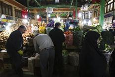 EDITORS' NOTE: Reuters and other foreign media are subject to Iranian restrictions on leaving the office to report, film or take pictures in Tehran.  Customers shop at a vegetable store in Tehran January 6, 2012. REUTERS/Raheb Homavandi