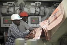 Labourers work at the Dangote Cement factory in Obajana village,  Nigeria.    REUTERS/Akintunde Akinleye