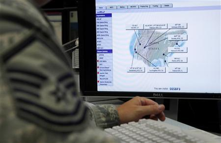 A map is displayed on one of the screens at the Air Force Space Command Network Operations & Security Center at Peterson Air Force Base in Colorado Springs, Colorado July 20, 2010.       REUTERS/Rick Wilking