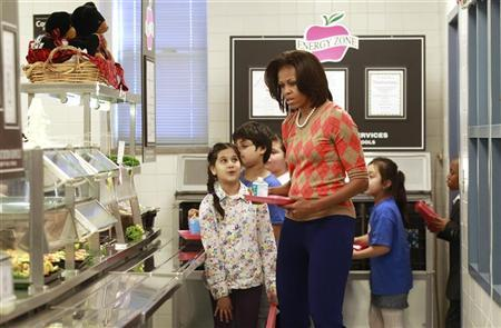 U.S. First Lady Michelle Obama joins the lunch line at Parklawn Elementary School in Alexandria, Virginia January 25, 2012.  REUTERS/Kevin Lamarque