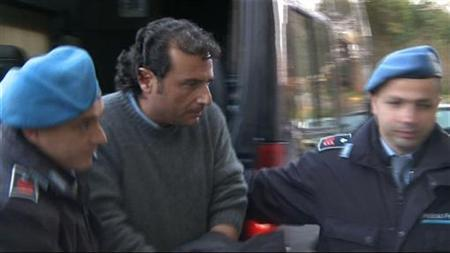 Captain Francesco Schettino (C) of cruise ship Costa Concordia is escorted into a prison by police officers at Grosseto, after being questioned by magistrates in this still image from a video January 17, 2012. REUTERS/Reuters TV/Files