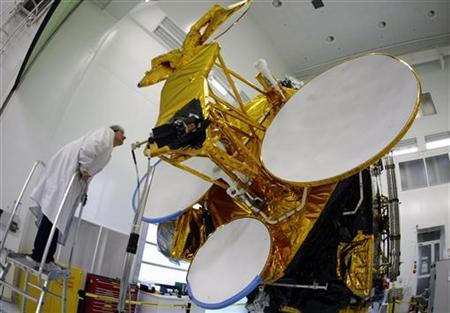 A technician checks a communications satellite during a press visit at Thales Alenia Space in southeastern France, October 7, 2009. REUTERS/Eric Gaillard