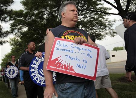 United auto workers and other activists protest outside a Coney Island restaurant where Republican presidential candidate Mitt Romney made a stop in Livonia, Michigan, June 9, 2011. REUTERS/Rebecca Cook