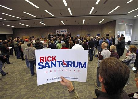A supporter holds a sign as Republican presidential candidate Rick Santorum speaks at a rally in Blaine February 7, 2012.  REUTERS/Eric Miller