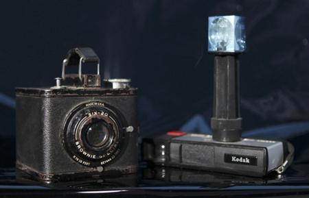 Two of Eastman Kodak's most successful cameras, a Brownie Special Six-20 (L), and the Pocket Instamatic 20 (R), are shown in this illustration January 12, 2012 file photo taken in Washington. REUTERS/Gary Cameron/Files