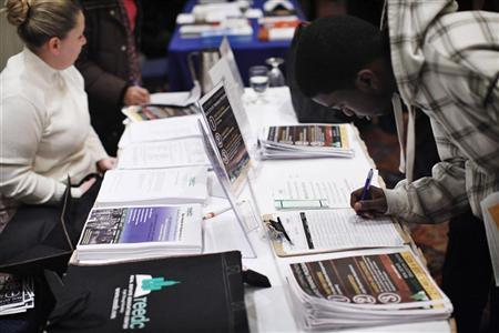 A man (R) writes down his details at a booth during the ''JobEXPO'' job fair in New York, January 25, 2012. REUTERS/Eduardo Munoz