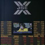 An electronic board displaying movements in major indices is seen at Johannesburg stock exchange in Sandton September 23, 2008. South African stocks stumbled and fell 1.3 percent on Friday, booking their first weekly decline since the start of 2012. REUTERS/Siphiwe Sibeko