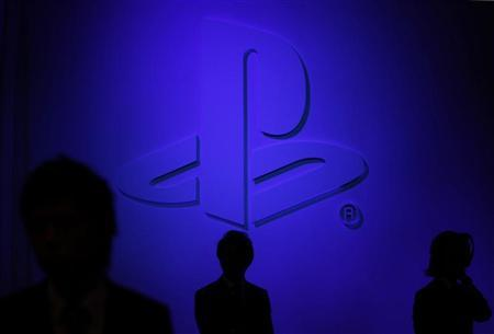 Visitos walk past the logo of Sony Playstation PS at Sony Computer Entertainment Japan news conference on the company's PlayStation Vita handheld games device in Tokyo, September 14, 2011. REUTERS/Kim Kyung-Hoon