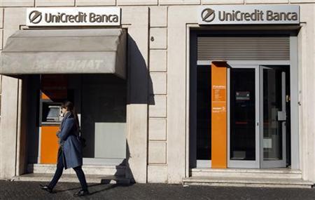 A women walk past a Unicredit bank in Rome November 14, 2011. REUTERS/Stefano Rellandini/Files