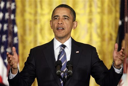 President Barack Obama gestures as he delivers remarks about providing states flexibility under No Child Left Behind in exchange for reform at the White House in Washington February 9, 2012.  REUTERS/Yuri Gripas