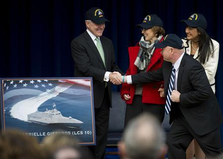 Secretary of the Navy Ray Mabus shakes hands with retired Navy Captain Mark Kelly (2nd R) as he announces the 10th littoral combat ship, LCS 10, will be named USS Gabrielle Giffords, as former U.S. Rep. Gabrielle Giffords (3nd R), from Arizona, looks on in Washington, in this handout photo February 10, 2012. Photo taken February 10, 2012. REUTERS/U.S. Navy-Chief Mass Communication Specialist Sam Shavers/Handout
