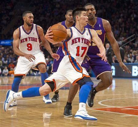 New York Knicks' guard Jeremy Lin (17) drives past Los Angeles Lakers' forward Metta World Peace in the third quarter of their NBA basketball game at Madison Square Garden in New York February 10, 2012. REUTERS/Ray Stubblebine