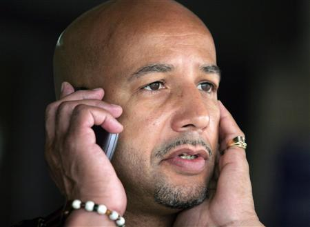 Mayor Ray Nagin talks on a mobile phone as he waits for rain to subside at an event commemorating the upcoming anniversary of Hurricane Katrina at the Superdome in New Orleans, Louisiana in this August 26, 2006 file photo. Former New Orleans Mayor Nagin, the colorful and controversial spokesman for the city after the devastating Hurricane Katrina in 2005, is under investigation by federal authorities, a source with direct knowledge of the probe said. The source told Reuters on February 10, 2012 that several people linked to Nagin or the New Orleans city administration during his two terms as mayor ending in 2010 were cooperating with the U.S. Justice Department and the FBI. REUTERS/Lee Celano/Files