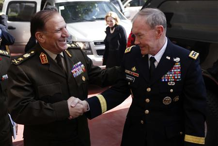 U.S. Chairman of the Joint Chiefs of Staff General Martin Dempsey (R) shakes hands with Lieutenant General Sami Anan, Egypt's armed forces chief of staff, upon his arrival to meet with head of Egypt's ruling military council Field Marshal Mohamed Hussein Tantawi at the Ministry of Defense in Cairo February 11, 2012.  REUTERS/Khalil Hamra/Pool