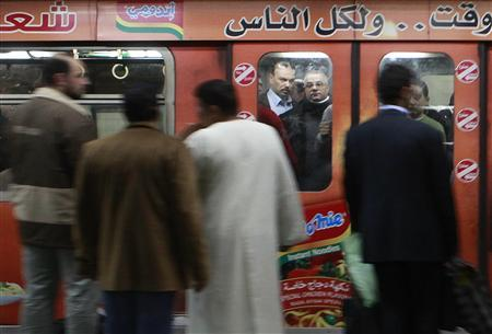 People ride in the underground train in Cairo, February 11, 2012.  REUTERS/Asmaa Waguih