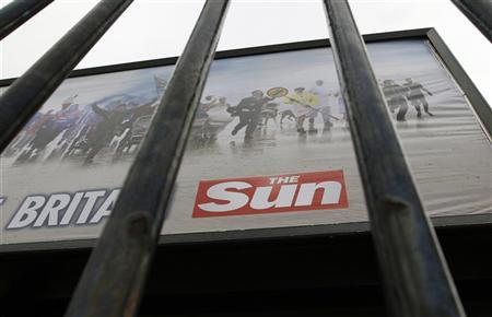 An advertisement for The Sun newspaper is seen on a billboard outside News International's Wapping headquarters in London January 28, 2012.  REUTERS/Chris Helgren