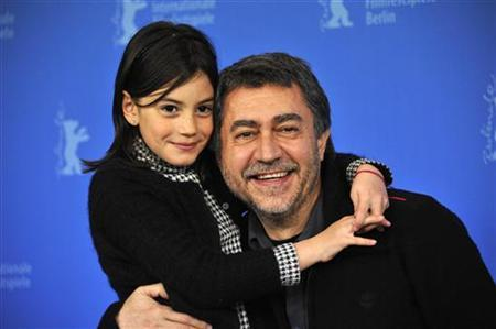 Director Antonio Chavarrias and cast member Magica Perez pose during a photocall to promote the movie 'Dictado' at the 62nd Berlinale International Film Festival in Berlin February 11, 2012. REUTERS/Morris Mac Matzen