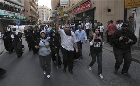 Bahrain's Human Rights Activits Nabeel Rajab (C) shouts anti-government slogans as he leads an anti-government protest held in downtown Manama February 11, 2012. REUTERS/Stringer
