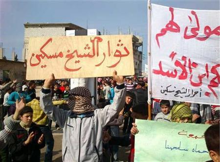 Demonstrators gather during a protest against Syria's President Bashar al-Assad, in Sheikh Meskeen near Deraa in this handout picture received February 12, 2012. The banner reads ''The revolutionaries of Shiekh Meskeen''. REUTERS/Handout