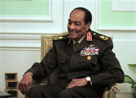 Egypt's ruling military council Field Marshal Mohamed Hussein Tantawi smiles as he meets U.S. Chairman of the Joint Chiefs of Staff General Martin Dempsey (not pictured) at the Ministry of Defense in Cairo, February 11, 2012.  REUTERS/Khalil Hamra/Pool