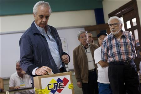 A man casts his vote at a polling station in Caracas February 12, 2012. REUTERS/Carlos Garcia Rawlins