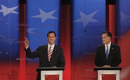 Rick Santorum speaks as Mitt Romney listens during the Republican presidential candidates debate in Tampa, Florida, January 23, 2012. REUTERS/Scott Audette