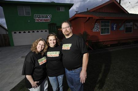 Sarah Hostetler (C) and her parents Beth and Scott pose in front of their home in Buena Park, California, February 11, 2012. REUTERS/Josh Edelson