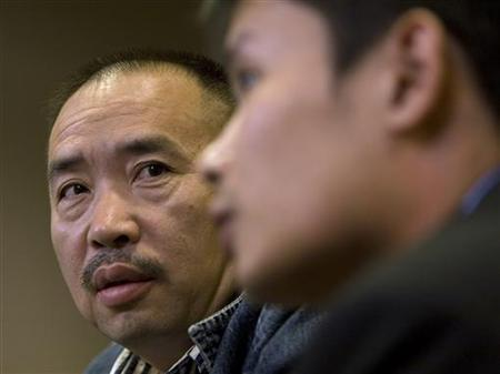 Lai Changxing, who has been called China's most wanted fugitive, listens to a translator during a news conference in Vancouver, British Columbia September 18, 2007. REUTERS/Andy Clark/Files