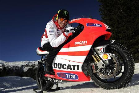 Ducati Moto GP rider Valentino Rossi smiles as he rides a Ducati Desmosedici Seater during the ''Wrooom, F1 and MotoGP Press Ski Meeting'', Ducati and Ferrari's annual media gathering in Madonna di Campiglio January 12, 2012 in this handout released by the Wrooom 2012 Press Office. REUTERS/Wrooom 2012 Press Office