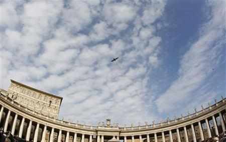 A bird passes overhead while Pope Benedict XVI leads the Sunday angelus prayer in Saint Peter square at the Vatican February 12, 2012. REUTERS/Tony Gentile