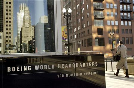A pedestrian walks past the Boeing World Headquarters office building in Chicago April 26, 2006.  REUTERS/Joshua Lott