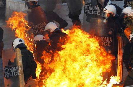 A petrol bomb explodes at riot police during a huge anti-austerity demonstration in Athens' Syntagma (Constitution) square February 12, 2012. February 12, 2012. REUTERS/Yannis Behrakis
