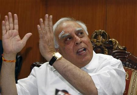 Telecoms Minister Kapil Sibal gestures during a news conference in New Delhi April 11, 2011. REUTERS/Adnan Abidi/Files
