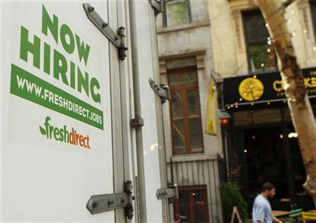 A ''Now Hiring'' sign is seen on the back of a Fresh Direct grocery delivery truck in New York City May 6, 2010.  REUTERS/Lucas Jackson