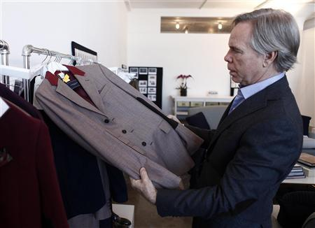 Designer Tommy Hilfiger shows one of his designs during a review of his Fall/Winter 2012 collection during New York Fashion Week, February 9, 2012.   REUTERS/Carlo Allegri