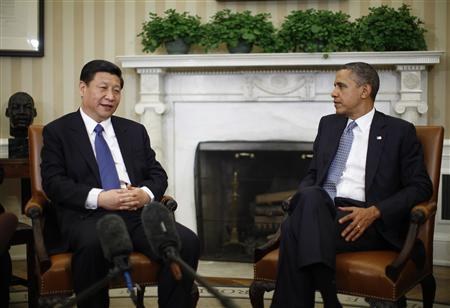 President Obama listens to China's Vice President Xi Jinping during their meeting in the Oval Office of the White House, February 14, 2012. REUTERS/Jason Reed
