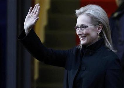 U.S. actress Meryl Streep waves as she arrives for a news conference during the 62nd Berlinale International Film Festival in Berlin February 14, 2012.    REUTERS/Fabrizio Bensch