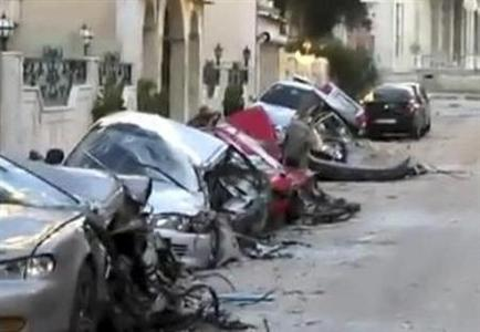Damaged cars are seen in Bab Amro, in the city of Homs, February 13, 2012.  REUTERS/Handout
